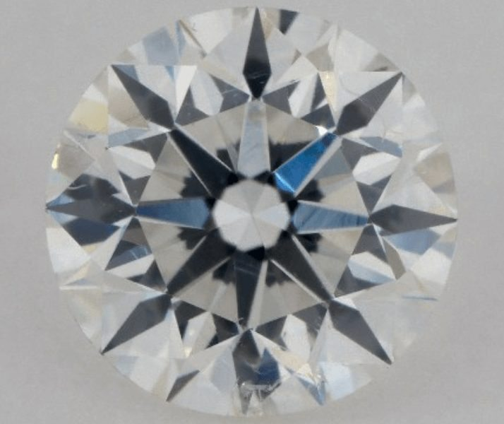 Diamond with little clouds under the crown facet