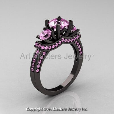 Black gold ring setting with light pink sapphires