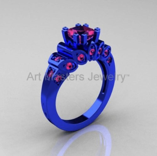 Pink Sapphire in blue ring setting