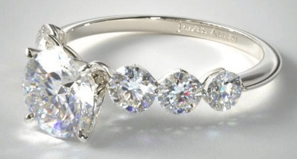 Sidestone scalloped shared prong engagement ring