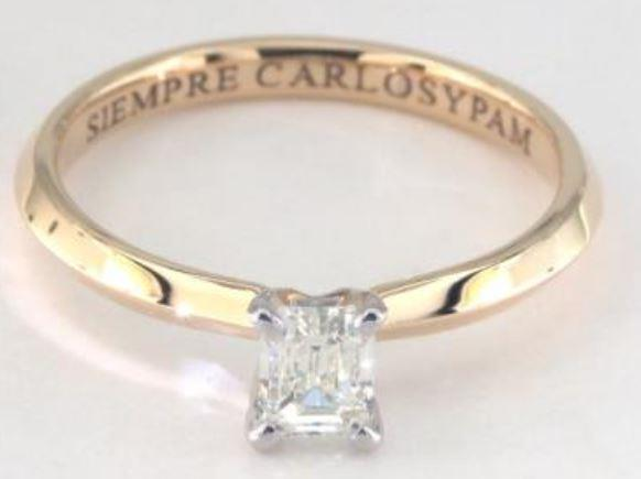 0.38ct K colored SI1 emerald cut diamond on a Solitaire yellow gold ring setting