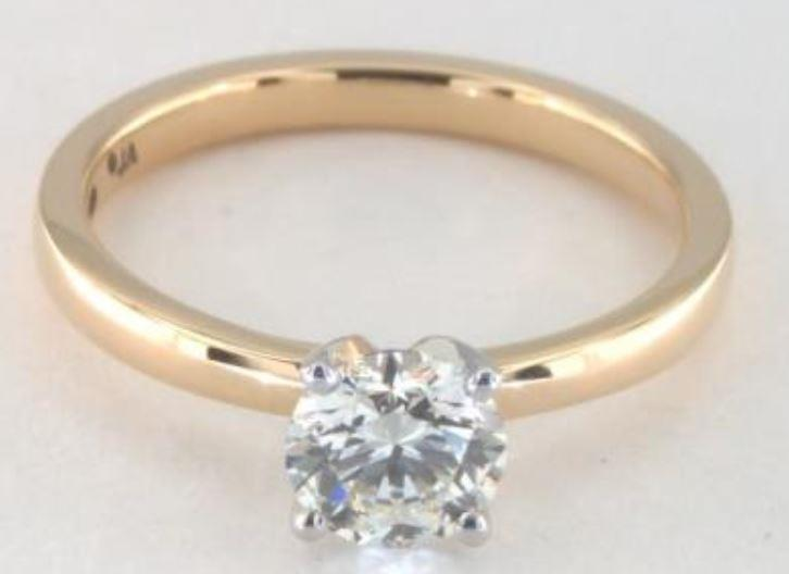 0.77ct H colored VS1 diamond on yellow gold Solitaire ring setting