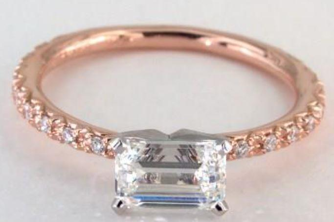 1.20ct K colored VS1 emerald cut diamond on a pavé rose gold ring setting