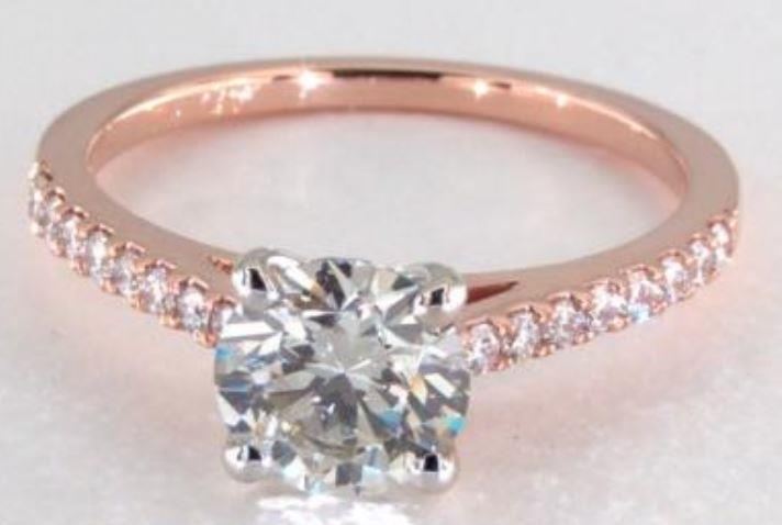 1.2ct K colored VS1 diamond on a rose gold pavé ring setting
