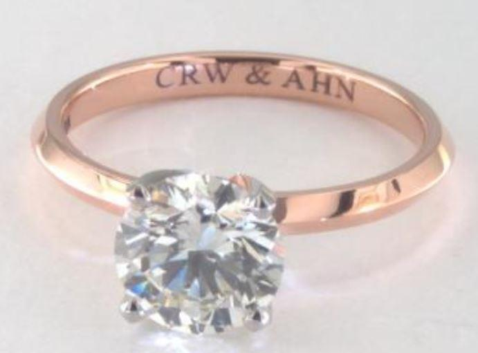 1.4ct J colored VS2 diamond set onto a solitaire rose gold ring setting
