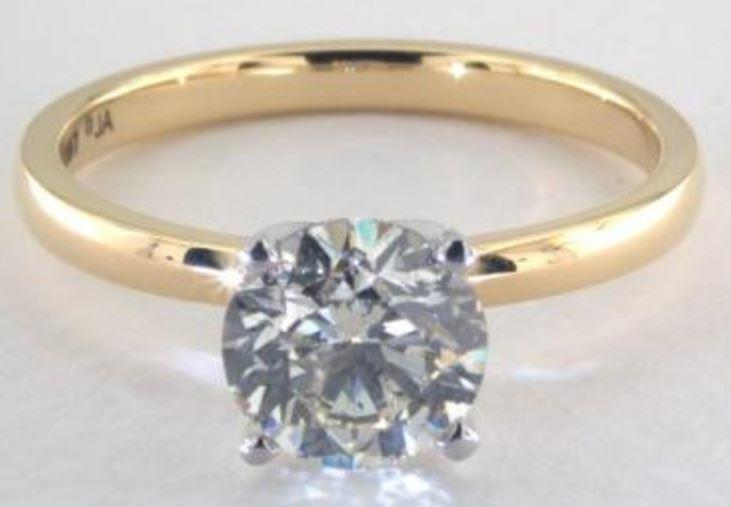 1.60ct J colored SI2 diamond on a Solitaire yellow gold ring setting