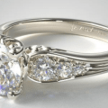 Sidestone Engagement Ring with a pave swirl
