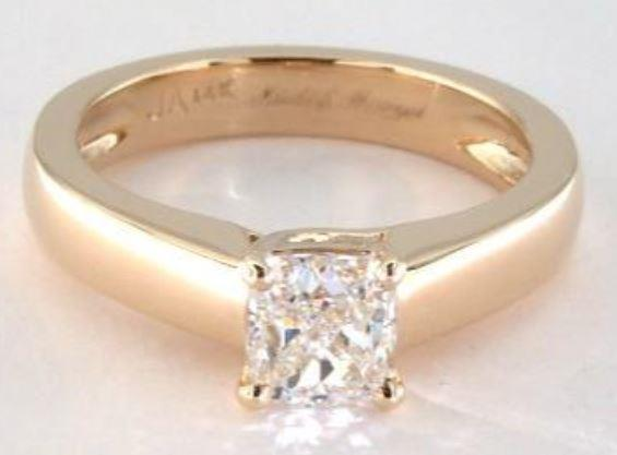 0.81ct H colored VS1 cushion cut diamond in a yellow gold Solitaire ring setting