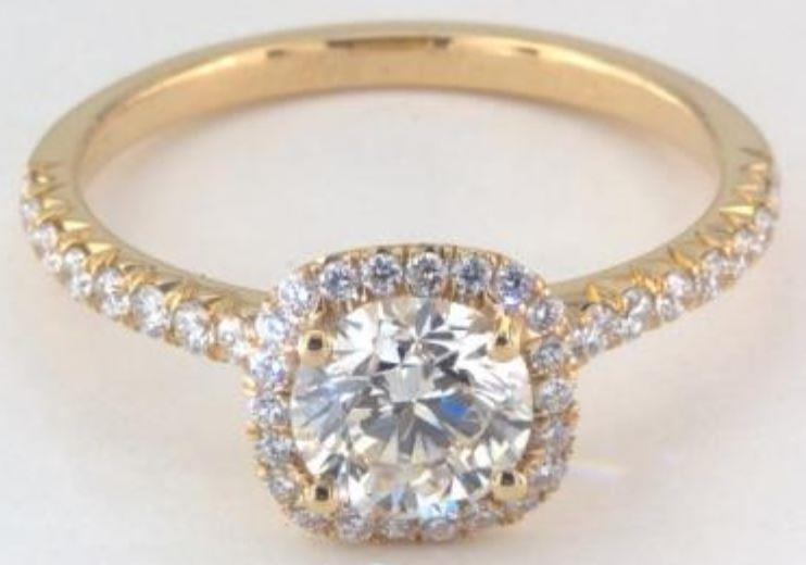 0.90ct J colored VVS2 diamond on a yellow gold Halo ring setting
