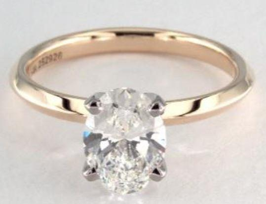 1.02ct H colored VS1 oval cut diamond on a yellow gold Solitaire ring setting