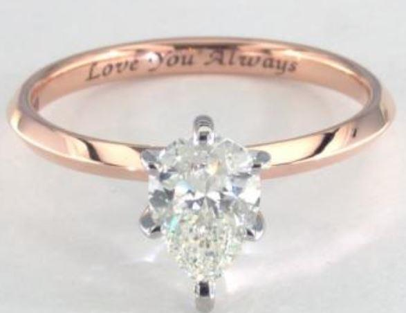 1.02ct J colored VS2 pear shaped diamond on a Solitaire rose gold ring setting