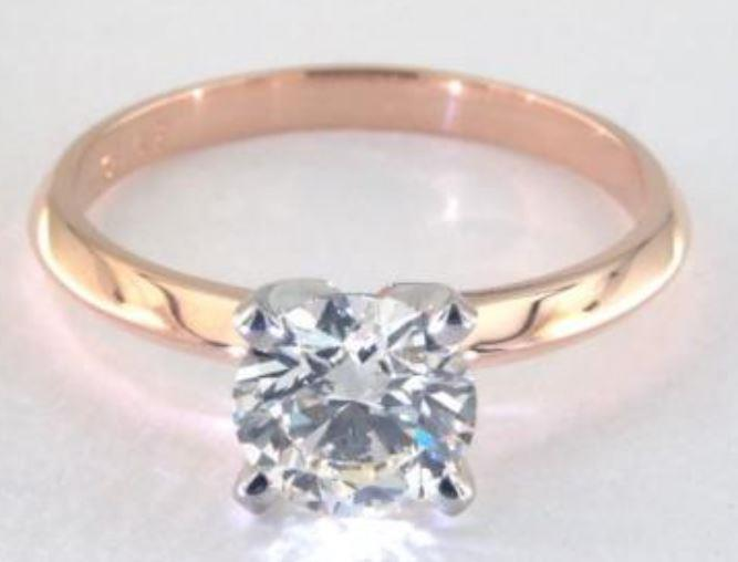 1.22ct K colored VS1 diamond set onto a Solitaire rose gold ring setting