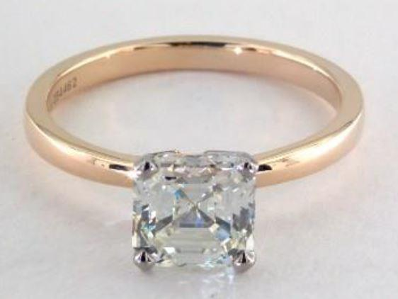 1.52ct K colored VVS2 Asscher cut diamond on a Solitaire yellow gold ring