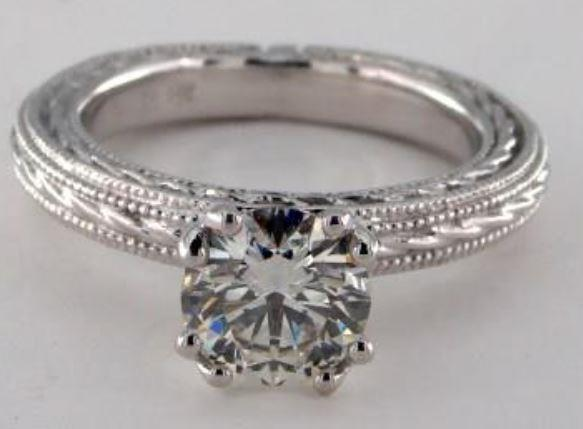 1.00ct J colored SI2 diamond on a white gold etched rope solitaire ring setting