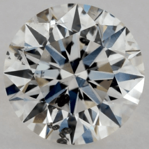 0.71 CARAT I-I1 EXCELLENT CUT ROUND DIAMOND with black crystal inclusion
