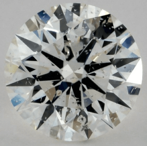 0.71 CARAT J-I1 EXCELLENT CUT ROUND DIAMOND with white crystal inclusion